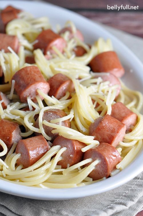 Threaded Spaghetti Hot Dog Bites - raw spaghetti is threaded through pieces of hot dog, then cooked. Kids and grown-ups alike will love this fun dish!