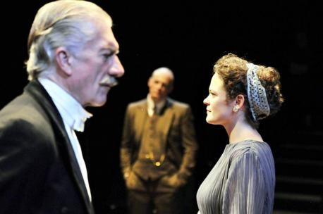 The Bolton News: Brian Protheroe as Arthur Birling, David Prosho as Inspector Goole and Rosie Jones as Sheila Birling in Bolton Octagon's showing of An Inspector Calls. Photo by Ian Tilton
