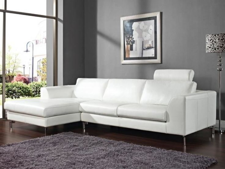 the angela leather sectional is a sectional that is made up of leather and is available in pure white smoke grey or stetson camel leather