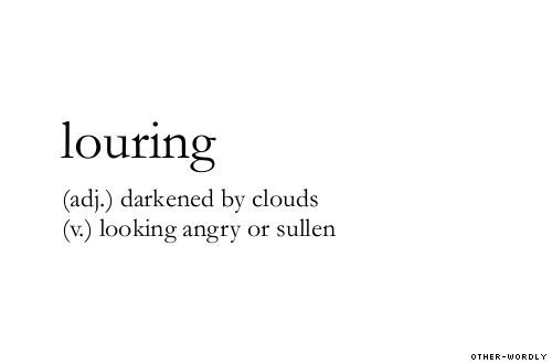 Louring. What a great word, makes your voice and face mimic the meaning.: