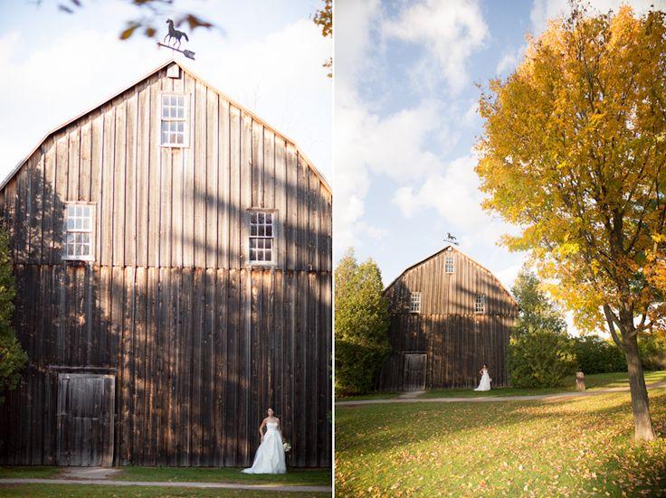 Vineland Estates bride poses in front of old wood barn