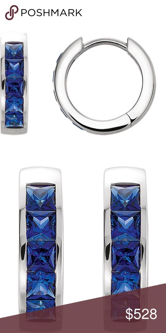 """Sterling Silver Blue Sapphire Hoop Earrings New in Gift Bag. """"Perhaps they were born there, among the shepherds pasturing their flocks where the wild flowers made a glory on the hillside; among the sailors on a sapphire sea washing enchanted islands purple in a luminous air.""""  These classic blue sapphire hoops are brilliantly simple yet amazingly luxurious in nature.  Weight: 3.64 g Length: 14.15 mm Width:  3.65 mm Finish: Polish Stone Shape: Princess Metal Purity: 14k Stone Size: 2.5 mm x…"""