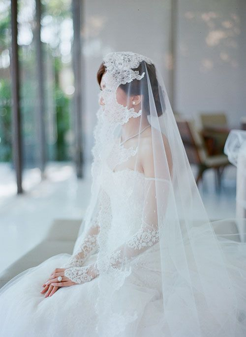 Bride in Custom Wedding Dress with Lace Sleeves | Brides.com