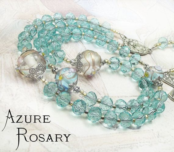 Beautiful rosaries to pray with. Unique Pale Mediterannan Azure Rosary with Glass Lampwork Our Father beads and Pale Azure Faceted Crystal & Caritas Crucifix