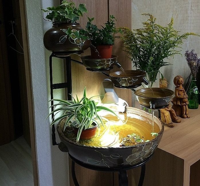 Place for gold fish indoor water falls down and fish for Aquarium waterfall decoration