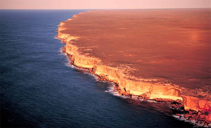 A small part of the cliffs of the Great Australian Bight and the beginnings of the Nullabor Plains. Nullabor isn't an aboriginal word..  it's null= none abor = trees