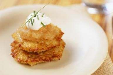 Crispy scallion potato pancakes with maple pear applesauce on top - Lisa Romerein/The Image Bank/Getty Images