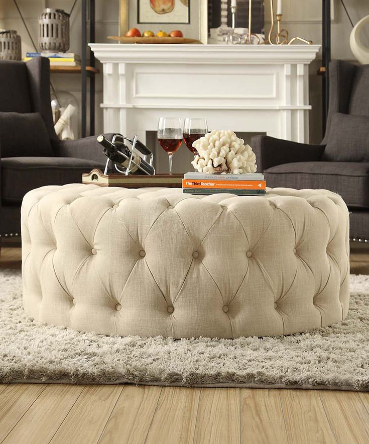 Beige Montvale Round Cocktail Ottoman $389. it's 16h x 41deep. great, don't know how well its made though?