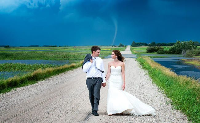 3 Couples Who Didn't Let a Little Crazy Weather Ruin Their Weddings | Photo by: Colleen Niska | TheKnot.com