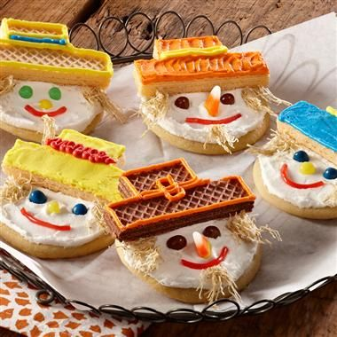 """Harvest Scarecrow Cookies: """"Dress"""" your favorite sugar cookies as a sweet scarecrow with their sugar wafer hats and shredded wheat straw hair. Try decorating them with family and friends to see who can make the most picture-perfect creation!"""