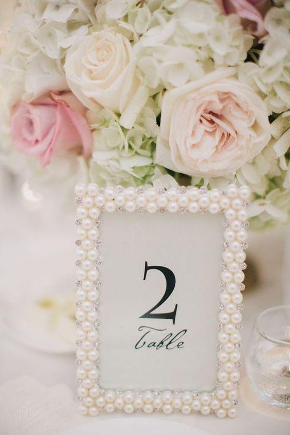 pearl picture frames wedding table decor / http://www.deerpearlflowers.com/vintage-pearl-wedding-ideas/