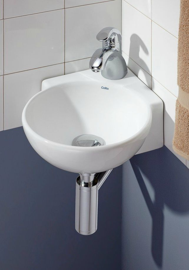 Ten Stylish And Compact Sink Solutions For Small Bathrooms Living In A Shoebox Small Bathroom Sinks Corner Sink Very Small Bathroom