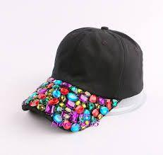 Image from http://g02.a.alicdn.com/kf/HTB1OIkcHVXXXXaAXpXXq6xXFXXXl/Haute-qualit%C3%A9-luxe-diamant-strass-papillon-femmes-denim-jeans-baseball-cap-new-mode-femme-hip-hop.jpg.