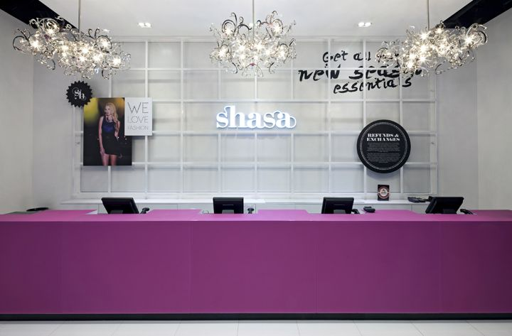 Reception idea - pendants / fun desk color. Brought to you by Shoplet.com, everything for your business!