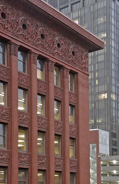 LOUIS SULLIVAN (American): Wainwright Building. St. Louis, 1890-91. The Wainwright building is credited for being the first successful utilization of steel frame construction.  The first two floors are faced in brown sandstone, the next seven stories rise in continuous brick piers.  Terra-cotta panels of ornate foliage relief decorate the each floor.