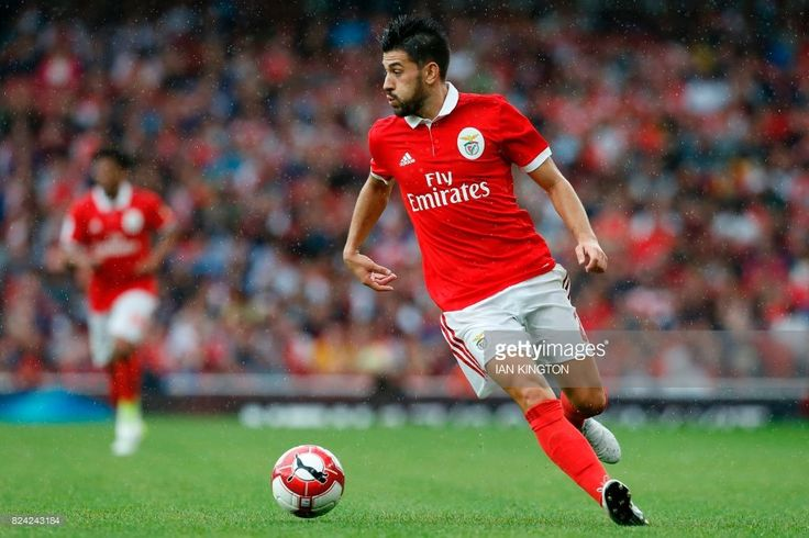 Benfica's Portuguese midfielder Pizzi runs with the ball during the pre-season friendly football match between Arsenal and Benfica at The Emirates Stadium in north London on July 29, 2017, the game is one of four matches played over two days for the Emirates Cup. / AFP PHOTO / Ian KINGTON / RESTRICTED TO EDITORIAL USE. No use with unauthorized audio, video, data, fixture lists, club/league logos or 'live' services. Online in-match use limited to 75 images, no video emulation. No use in…