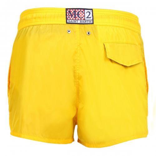 YELLOW NYLON SWIM SHORTS - Solid color Nylon Swim Shorts with two front pockets and a single snap-button back pocket. Internal net. Elastic waistband with adjustable drawstring. #mrbeachwear #mc2 #boardshort #fashion #man #summer #style