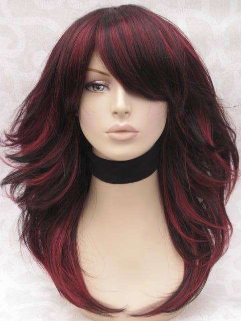 I know I'm kind of old for this color but I like it! mage detail for -hair cut dyed black hair red highlights