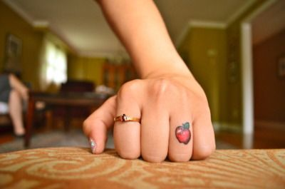knuckle tattoo... i love the irony of the tough knuckle with the innocent apple... I would make mine a strawberry though