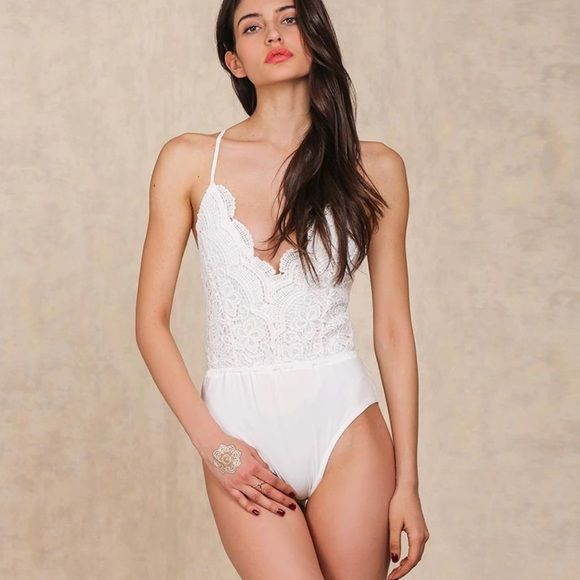 In Stock! White Lace bodysuit ✨White Deep V Lace Bodysuit✨ *Size S, M, L *New Direct from vendor *Cotton/Polyester/Spandex *Color is White. *Price firm unless bundled *15% off bundles! Shop108 Tops Camisoles