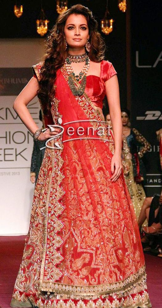 Bollywood Beauty Dia Mirza showcases a creation by Designers Shyaml and Bhumika during the Lakme Fashion Week (LFW) Winter/Festival 2013 in Mumbai. She is completely hidden in threads and motifs head to toe. Amazing craftsmanship is done over her dress, designer velvet choli add more elegant catch to her outfit.: Outfit