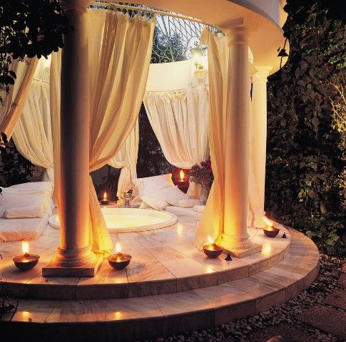 Backyard spa..I have no words! I wonder if I can find a DIY tutorial on fixing some drapes around the hot tub?