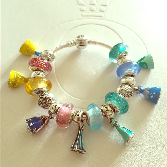 Disney Pandora Princess Set of 18 Dresses & Murano This listing is for 18…