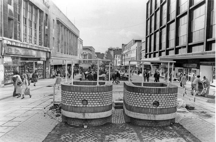 Brick Trams, The Moor showing Quadrant Stationers: Woolworths and Debenhams