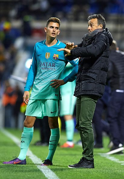 Luis Enrique Manager of FC Barcelona gives instructions to his player Nili Perdomo during the La Copa del Rey first leg match between Hercules CF and...