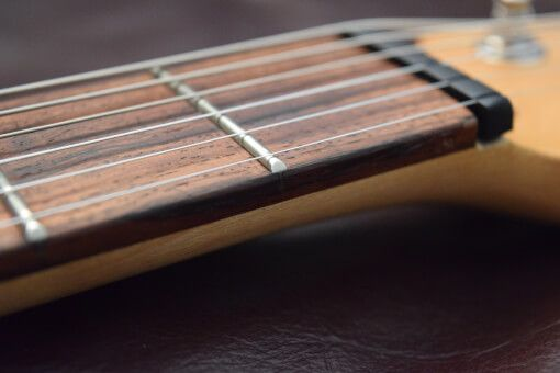 One of the main causes of guitar playability issues is the guitar nut height. Find out how to solve this problem quickly, easily and cheaply. Source: adamharkus.com