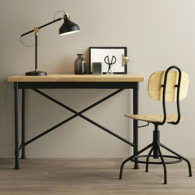 With all the appeal of a vintage industrial chair but with the functionality of a modern task chair, this swivel chair adjusts up and down to fit the height of your work surface