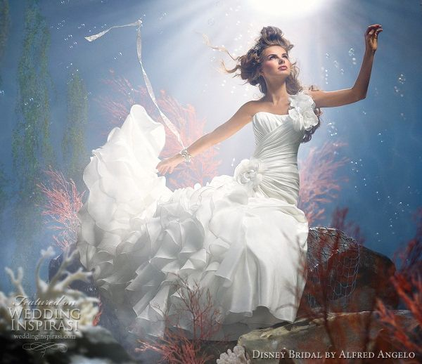 Disney Fairy Tale Weddings by Alfred Angelo 2012 bridal collection - Arial one-shoulder taffeta gown with cascading organza ruffles, fabric flowers and feather accents and semi-cathedral train.