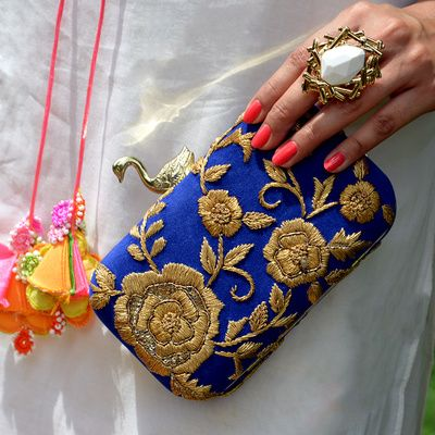 blue and gold clutch , swan motif , metallic ring , embroidered bag