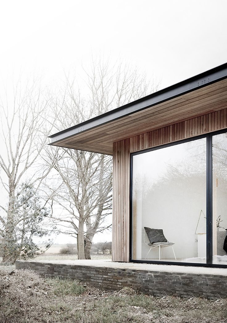 on the border of a working farm in the english county of suffolk, norm architects has designed a dwelling conceived as a flat roofed pavilion.