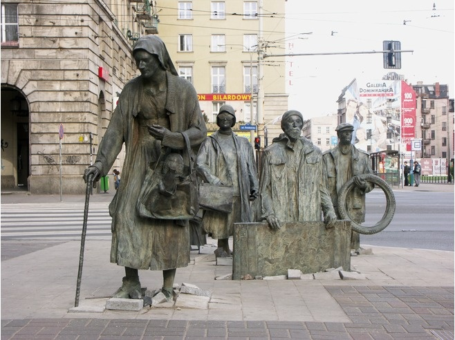 "The Anonymous Pedestrians are 14 bronze statues representing the people who disappeared during the introduction of martial law in Poland on the 13th December 1981. The memorial which was designed by Jerzy Kalina was erected in December 2005. The correct name of the artistic work is ""Transition"" (Przejscie).Directions: The Anonymous Pedestrians statues can be found on the pavement at the street corner of Pilsudskiego and Swidnicka which is located about 1,5 km south of the Market Square…"