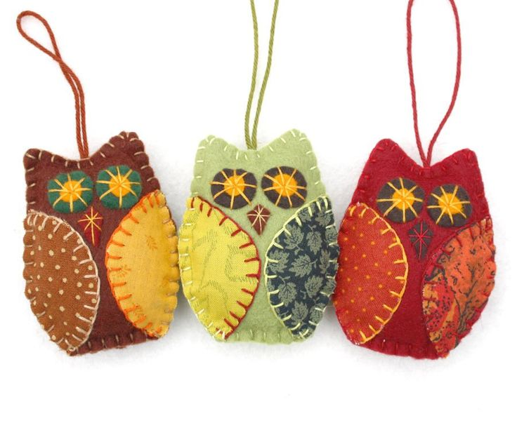 Three owl ornaments in autumn, fall colors, handmade from felt and cotton prints with hand embroidered details. Each owl is 8cm high and has a cotton loop for hanging. The listing is for a set of 3 ow                                                                                                                                                                                 More