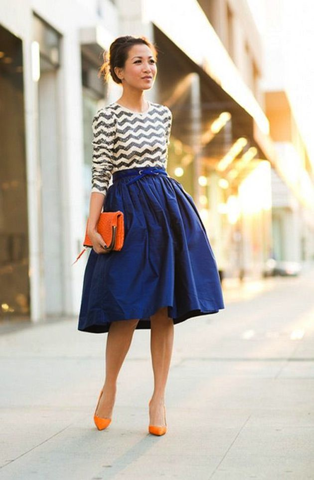 Awesome use of pattern and color. The orange hue pops well with the blue skirt. Nice, fun look.
