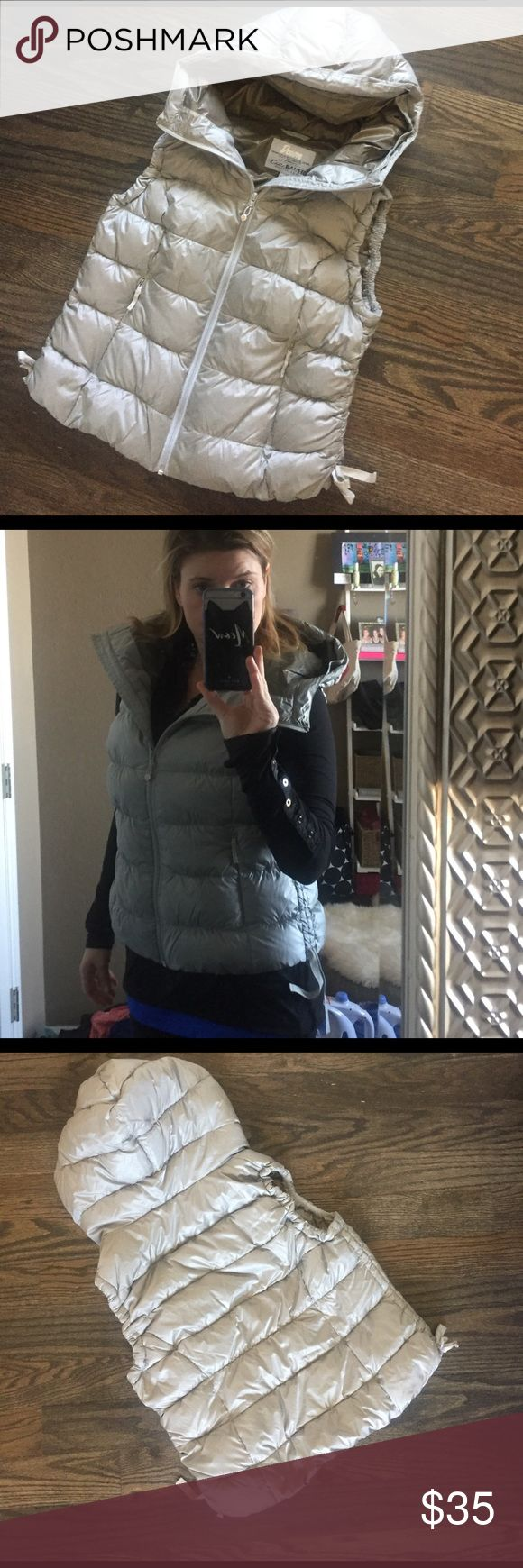 "Eddie Bauer 550fp down Puffer Vest L LP Cute & cozy down puffer hoody vest from Eddie Bauer in petite large but I'm 5'5 1/2 and fit. Sides have adjustable scrunchy ties which add a great effect when layering & also flatter the waist. Gray/silver color. Gently used with no notable issues. 2 front zipper pockets. 20.5"" across underarms & 21"" long. Eddie Bauer Jackets & Coats Vests"