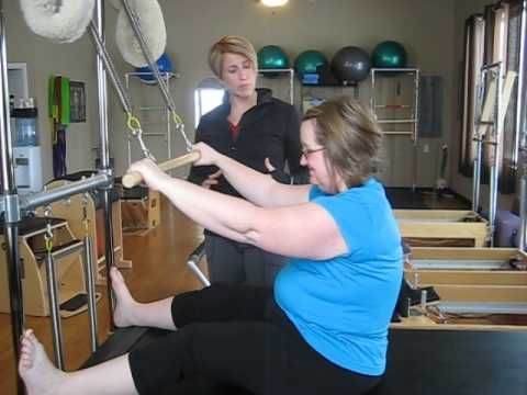 Pilates: How to perform the roll down on the Cadillac.