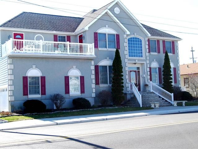 Custom Built Home on Corner Property in Popular Wildwood Crest a short stroll to beach. Two Car Garage with opener Classic Colonial Styling. Stunning Stairs to the Two Story Foyer Entrance featuring Harwood Flooring and a Dynamic turned Stairs. The Chandelier is electronically controlled for easy cleaning and the home is equipped with security system. A formal Sunken Living Room connects to A Spacious Dining Room that can handle large Family functions. Moving into the Dream Kitchen with…