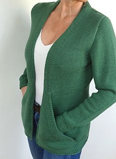 A relaxed DK weight cardigan with gentle waist shaping, a flattering V-neck and super useful big pockets.
