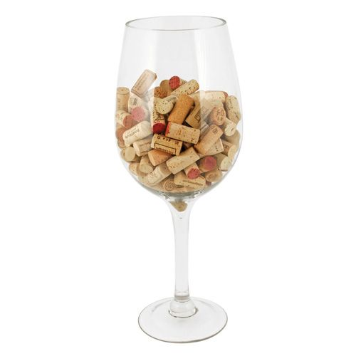 """The Oversized Wine Glass Cork Holder is an extra large 20"""" big Bordeaux wine glass that makes an impressive holder for wine corks. This giant wine glass holds hundreds of corks (not included) turning cork clutter into a decorative display. The Oversized Wine Glass, in the classic Bordeaux shape, can be used as a wine chiller or an ice bucket for serving champagne or a party punch bowl! The Oversized Wine Glass is also a fun place to keep candy, tips, change, business cards, and more. The…"""