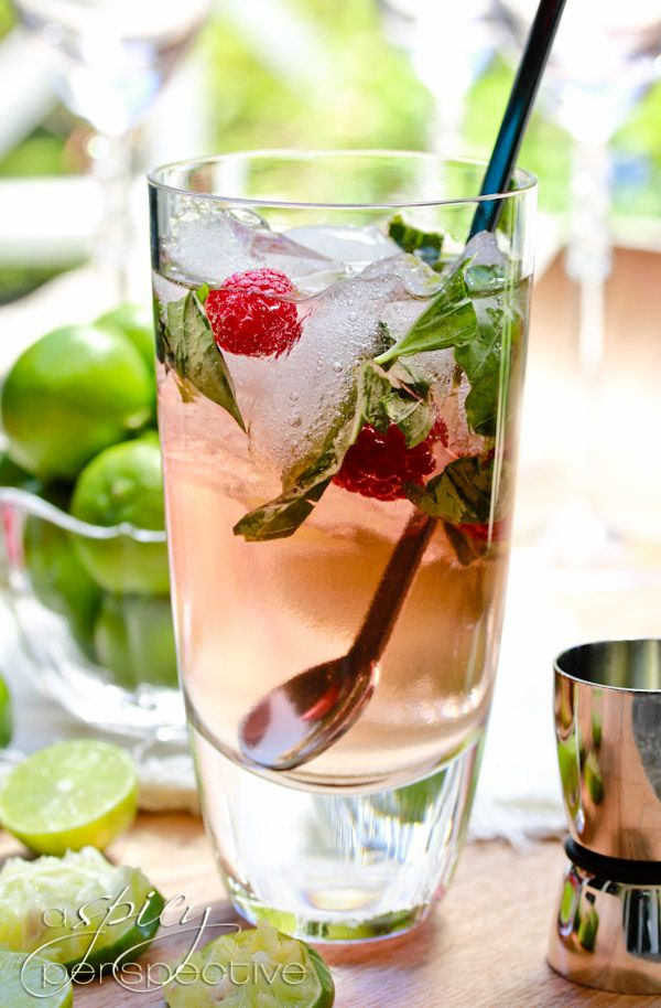 Ingredients: 1 cup simple syrup ( 3/4 cup sugar + 3/4 cup water, heated to dissolve)  1/2 cup torn basil leaves  1 cup FRESH key lime juice (use regular limes for slightly less acidity)  2 cups white rum  1/4 cup Chambord (raspberry liquor)  1 liter club soda  ice  fresh raspberries and lime slices to garnish
