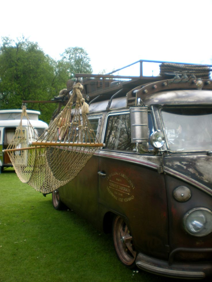 VW Camper Van with Hammock attached to the side.                                                                                                                                                                                 More