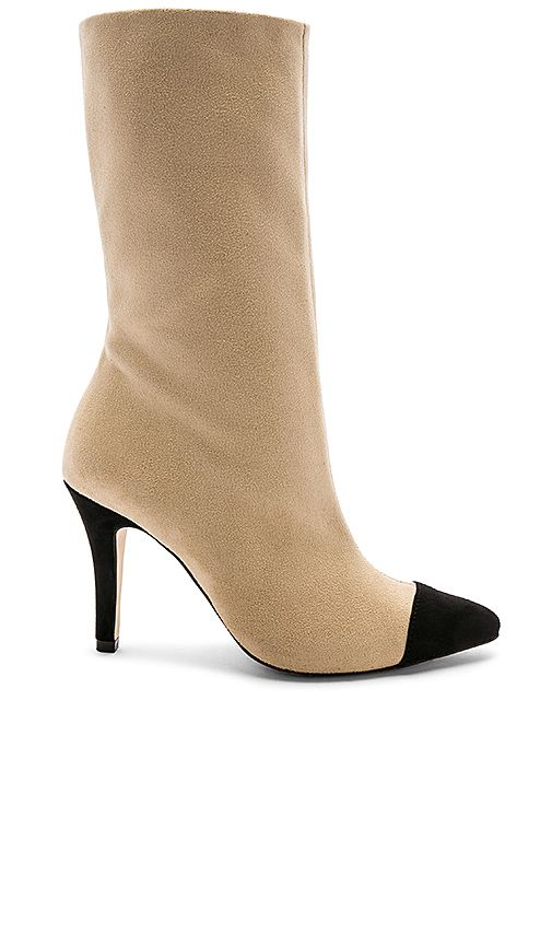 6244da920e8e Chanel two tone boot dupe! Looks just like the Chanel cap toe boots but a  fraction of the price! #ootd #chanel #boots affiliate