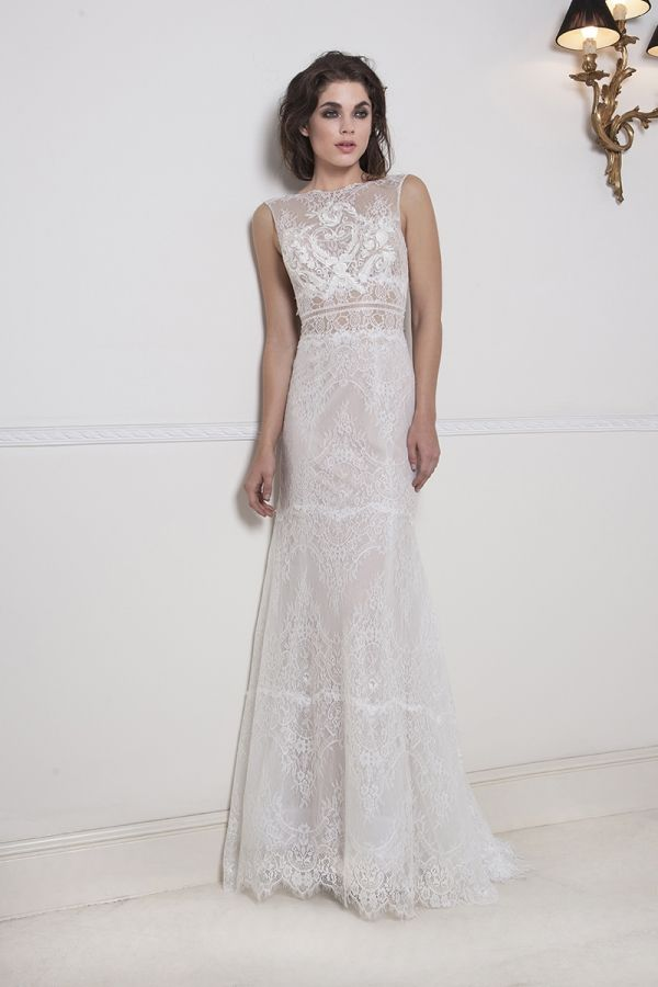 Ivory tight A-line dress made with a combination of French Chantilly lace and Guipure lace