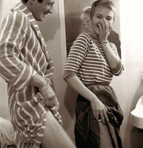 Jean Seberg & Jean Paul Belmondo on the set of Jean-Luc Godard's Breathless. Photographed by Raymond Cauchetier.