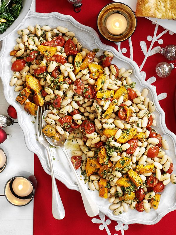 You can roast the squash and tomatoes ahead for this easy salad and make the basil dressing ready for serving as a canapé at your next drinks party.