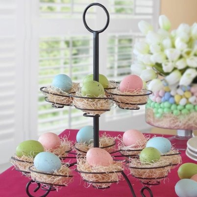 Easter Egg Centrepiece What a fun & festive idea! Use our Cupcake Serving Stand to display Easter eggs to recreate this colourful centrepiece! Find out more at www.EverydayStyle.com.