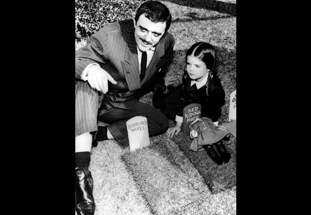 Child actress Lisa Loring and John Astin in The Addams Family, Child stars (Everett Collection)